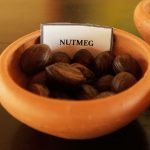 Herbal Demonstration Nutmeg in a clay bowl