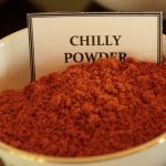 Herbal Demonstration red Chilli Powder in a white bowl